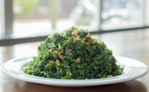 Green Kale salad on white plate